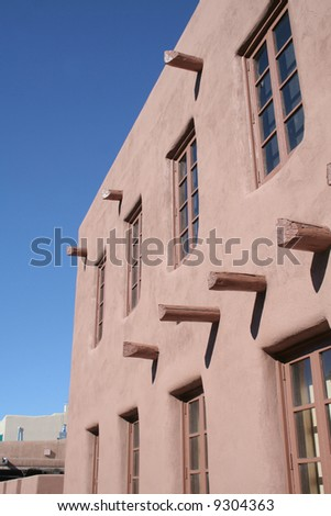 Adobe stucco building with blue sky background - stock photo