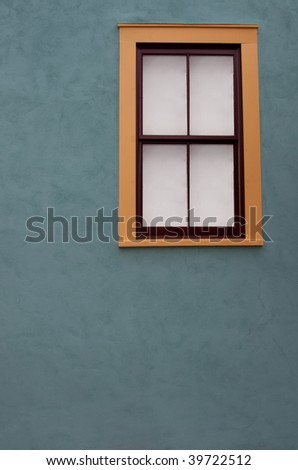 Adobe window in historical South Western wild west town - stock photo