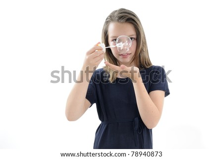 adolescent girl playing with bubble