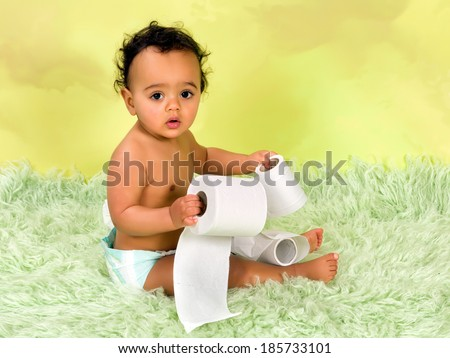 Adorable african baby boy playing with toilet paper - stock photo