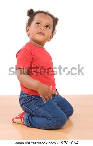 Adorable african baby kneel down over wooden floor - stock photo