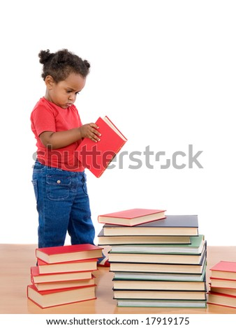 Adorable african baby reading with many pile of books - stock photo