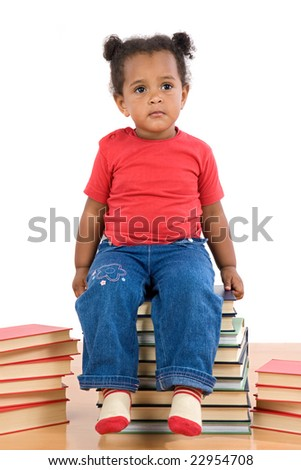 Adorable african baby sitting on a pile of books on a over white background