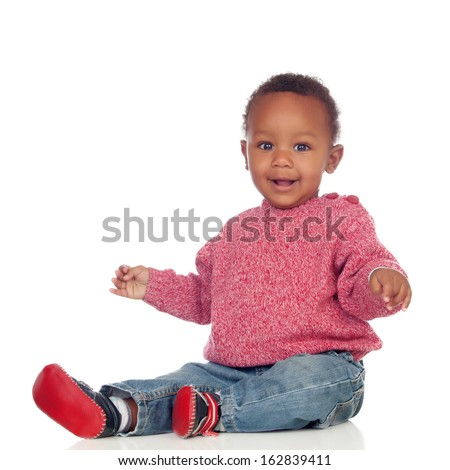 Adorable african baby sitting on the floor isolated on a white background