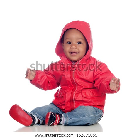 Adorable african baby sitting on the floor with red raincoat isolated on a white background - stock photo