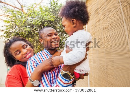 adorable african family at balcony - stock photo