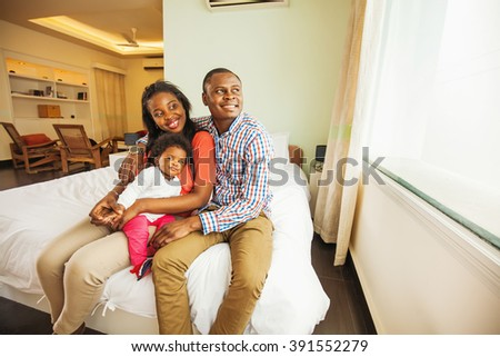 adorable african family at home - stock photo