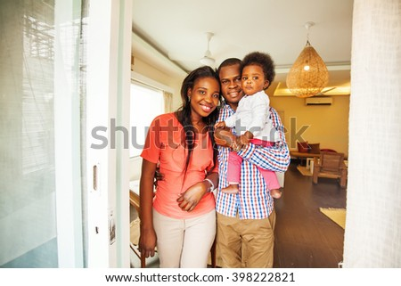 adorable african family in their home - stock photo
