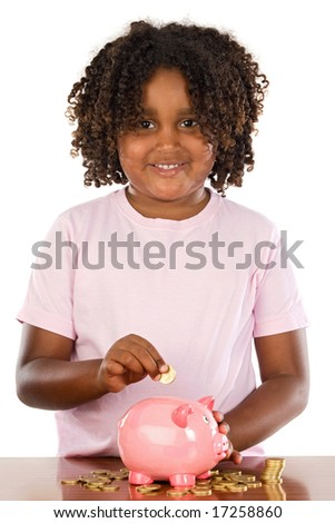 Adorable african girl putting a coin in a piggbank a over white background