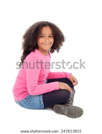 Adorable african little girl sitting on the floor isolated on white background