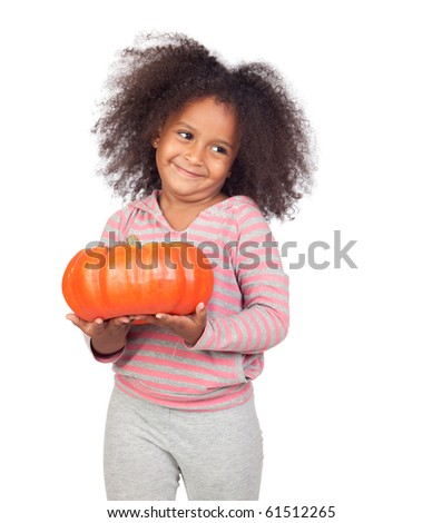 Adorable african little girl with beautiful hairstyle with a big pumpkin isolated over white
