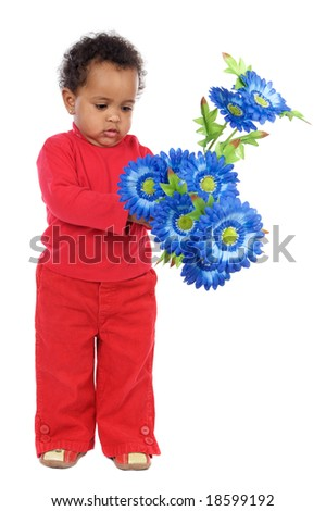 Adorable and beautiful african baby with flowers on a over wooden floor