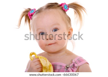 adorable and cute toddler eats banana, enjoying and posing - stock photo