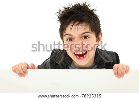Adorable and funny 8 year old boy making silly animal face while holding blank canvas over white.