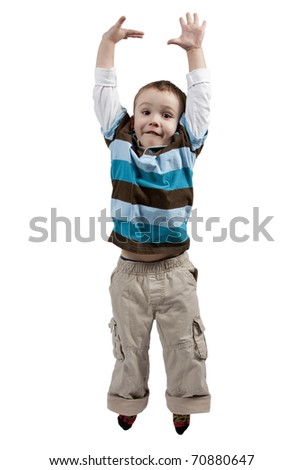 Adorable and happy little boy jumping in air. isolated on white background - stock photo