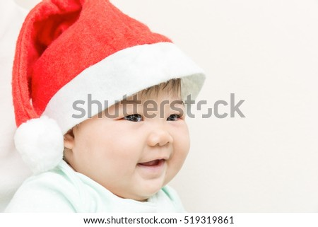 Adorable asian baby cute girl smiling with copy space in Christmast theme. (Vintage tone)