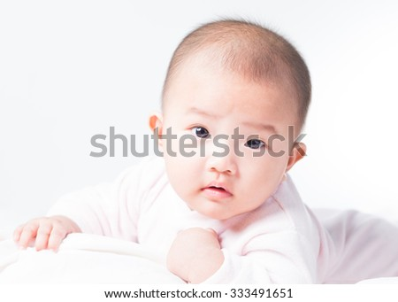 Adorable Asian baby 4-5 months old on white bed & background. Portrait studio light isolated. - stock photo