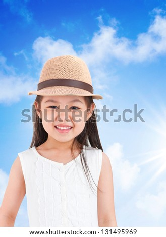 Adorable asian girl wearing hat under hot summer day - stock photo