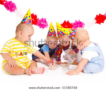 Adorable babies taking birthday cakes with candles - stock photo
