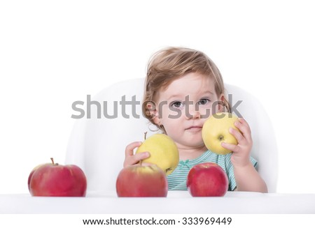 Adorable baby and apples, healthy food concept