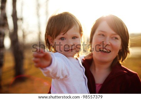 Adorable baby and  her mother - stock photo