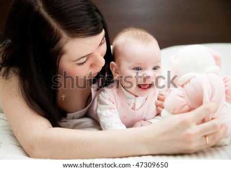 Adorable baby and mother in home - stock photo