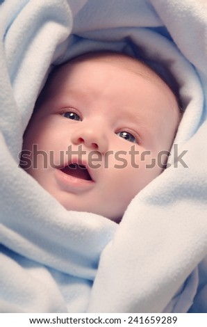 Adorable baby boy in blanket - stock photo