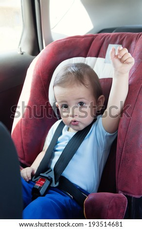 Adorable baby boy  in safety car seat - stock photo