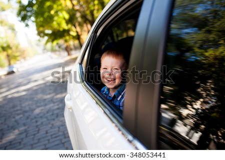 Adorable baby boy in the car - stock photo