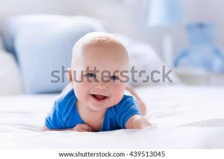 Adorable Baby Boy White Sunny Bedroom Stock Photo