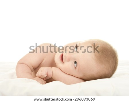 Adorable baby boy lying on a blanket on a white background - stock photo
