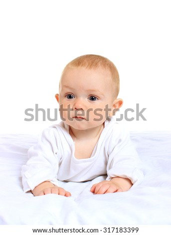 Adorable baby boy  on blanket  in cute clothes on a white background