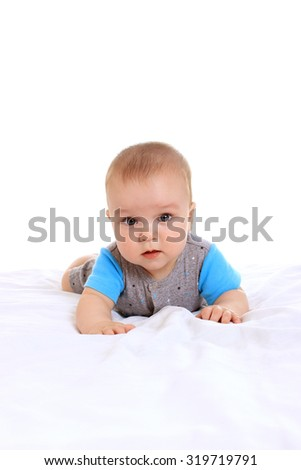 Adorable baby boy  on blanket  in cute clothes on a white background - stock photo