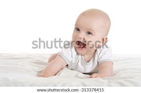 Adorable baby boy   on blanket on a white background - stock photo