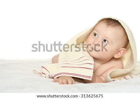 Adorable baby boy  on blanket on a white background
