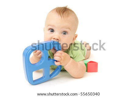 Adorable Baby Boy playing with blocks and shapes, on white background - stock photo
