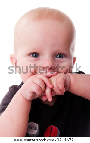 adorable baby boy sucking on his hands