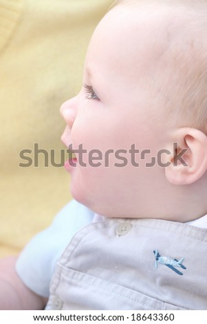 Adorable baby boy with blue eyes, with his mom - stock photo