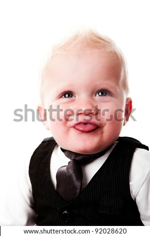 adorable baby boy with business suit and tie in studio