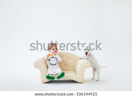 Adorable baby boy with dog - stock photo