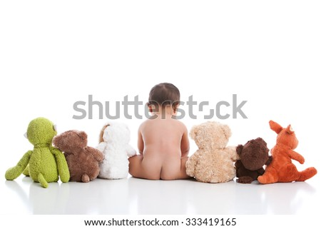 Adorable baby boy with his stuffed animals.  Isolated on white with room for your text. - stock photo