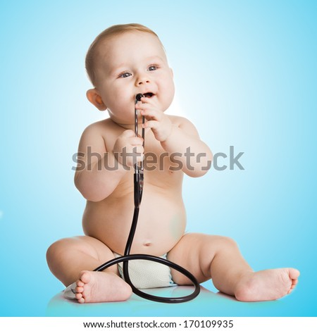 Adorable Baby Boy  with stethoscope on blue background - stock photo