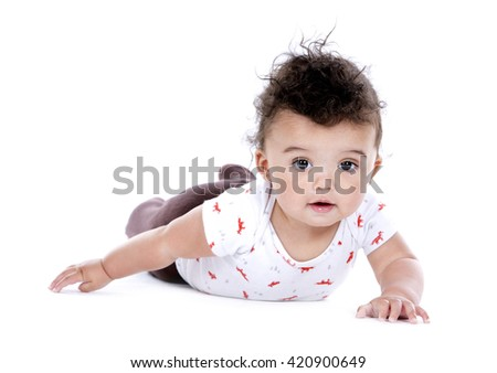 adorable baby boy wrapped with blanked on white background