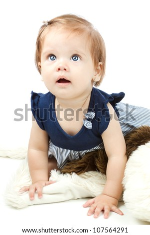 Adorable baby, caucasian, blonde and with stunning blue eyes. The girl is isolated on white. The kid is playing with toys. - stock photo