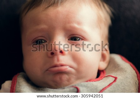 Adorable baby crying and being sad - stock photo