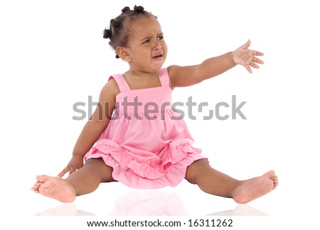 Adorable baby crying with reflex on ground - stock photo