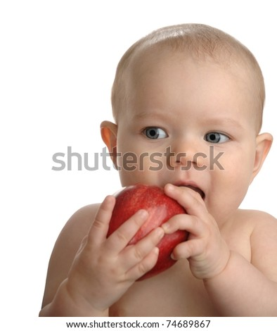 Adorable baby girl a red apple isolated on a white background. - stock photo