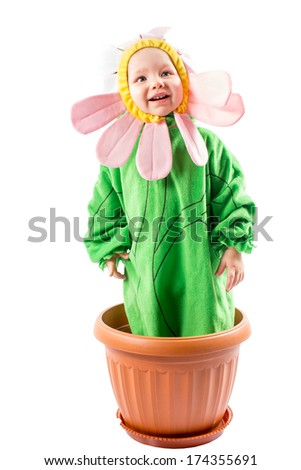 Adorable baby girl dressed in flower costume on white background - stock photo