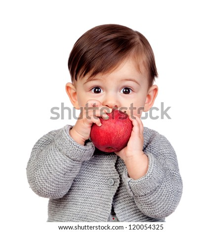 Adorable baby girl eating a red apple isolated on white background - stock photo
