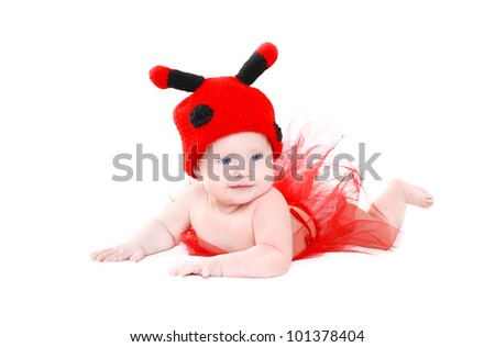 Adorable baby girl in funny ladybird hat and red tutu lying on white background